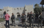 Israeli border police stand guard next to the Damascus gate outside Jerusalem's Old City, ahead of a planned march by Jewish ultranationalists throu