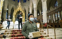 Mourners carried the remains of loved ones after the blessing of the ashes of Mexicans who died from COVID-19 at St. Patrick's Cathedral in New York
