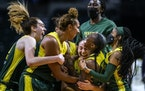 Seattle Storm's Jewell Loyd is mobbed after she hit the game-winner against the Dallas Wings as time expired on June 4.