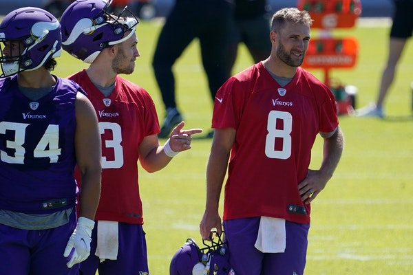 Minnesota Vikings quarterback Kirk Cousins (8) watched his teammates during the first day of mandatory minicamp Tuesday in Eagan.