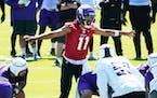 Minnesota Vikings quarterback Kellen Mond runs a play during NFL football minicamp practice Tuesday
