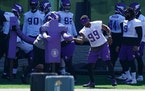 Vikings defensive end Danielle Hunter (99) took a limited part in drills during the first day of mandatory minicamp Tuesday in Eagan.