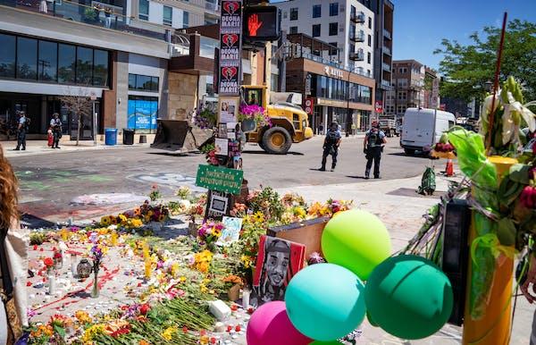 The scene Tuesday near W. Lake Street and S. Fremont Avenue, near where Deona Knajdek and Winston Smith were killed.
