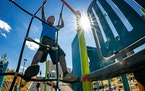 Boah McCulloch, 6, climbed on the new playground. Skyline Tower is in the background.