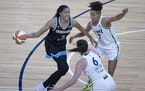 Chicago's Candace Parker dribbled to the basket on the Lynx's Layshia Clarendon (7) and Bridget Carleton (6).