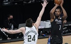 Brooklyn Nets forward Kevin Durant shoots as Bucks guard Pat Connaughton defends during the fourth quarter of Game 5