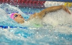 Regan Smith of Lakeville won the 100-meter backstroke to qualify for the Olympics on Tuesday.