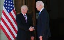 Russian President Vladimir Putin, left, and U.S President Joe Biden shake hands during their meeting at the 'Villa la Grange' in Geneva, Switzerla