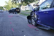 Police say a teenager was killed by a hit-and-run driver in north Minneapolis. Here, parked vehicles that were struck by the hit-and-run driver and se
