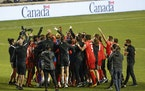 Canada celebrates a 3-0 win over Haiti in a World Cup qualifying soccer match, Tuesday, June 15, 2021, in Bridgeview, Ill. (AP Photo/Kamil Krzaczynski