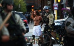 A protestor is arrested by Minneapolis police as they clear out barricades put up by protestors on W. Lake Street in Uptown on Tuesday, June 16, 2021,