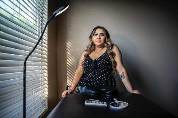 Luz Portillo at home in Avondale, Ariz., where she receives clients for her eyelash extension business, on May 30, 2021. Portillo plans to delay pregn