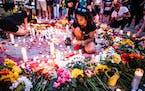Nae Totushek lights candles in honor of Deona M. Knajdek, late Monday, June 14, 2021, in Minneapolis. Knajdek was killed a day earlier when a vehicle