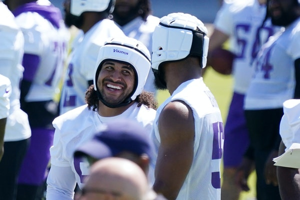 Eric Kendricks jokes with Anthony Barr (55) during minicamp.