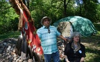 Tommy Tomahawk, tribal relations, and Mendota Mdewakanton Dakota Tribal Community chairperson Sharon Lennartson sat in the shade in front of a sweat l