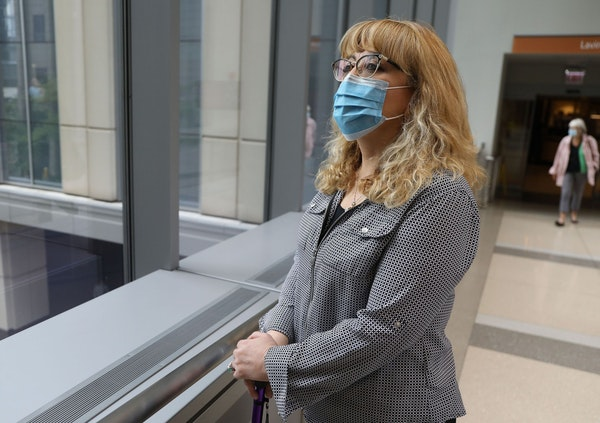 Sandra Wilson-Muriel, 54, arrives for her appointment at Northwestern Hospital Lavin Pavilion in Chicago, May 20, 2021. Muriel is a COVID long-hauler.