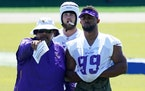 Danielle Hunter (99) with Vikings assistant head coach Andre Patterson.