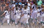 Rosemount�s Paige Zender (5) celebrated with her teammates as she crossed home plate after hitting a grand slam in the fifth inning of the Class 4A