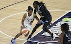 Minnesota Lynx's Crystal Dangerfield drives against Chicago Sky's Kahleah Copper during the second half