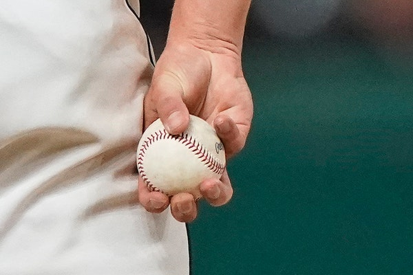 """A pitcher caught using a """"sticky'' substance will be suspended for 10 games — with pay."""
