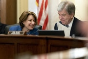 Senate Rules and Administration oversight Chair Sen. Amy Klobuchar, D-Minn., left, speaks with Sen. Roy Blunt, R-Mo., during a hearing Wednesday on th