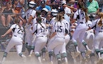 Rosemount's Paige Zender (5) celebrated with her teammates as she crossed home plate after hitting a grand slam in the fifth inning of the Class 4A