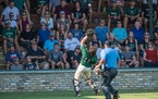 Park of Cottage Grove catcher William Smoot caught a foul popup behind home plate in the Wolfpack's 5-4 victory over Andover in a Class 4A semifinal