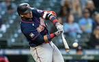 Nelson Cruz hits a three-run home run off Seattle Mariners starting pitcher Justus Sheffieldv during the fifth inning
