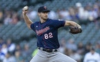 Twins starter Bailey Ober delivers a pitch during the first inning against the Seattle Mariners