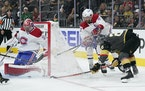 Montreal Canadiens goaltender Carey Price blocks a shot by Vegas Golden Knights left wing William Carrier, right, during the second period in Game 2