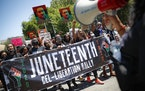 FILE- In this June 19, 2020, file photo, protesters chant as they march after a Juneteenth rally at the Brooklyn Museum, in the Brooklyn borough of Ne
