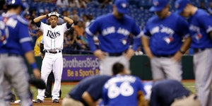 Tampa Bay's Desmond Jennings reacted as medical personnel attended to J.A. Happ after Happ, pitching for the Blue Jays, was struck by a line drive o