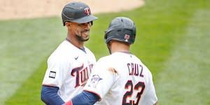 Minnesota Twins' Byron Buxton, left, celebrates with Nelson Cruz, right.