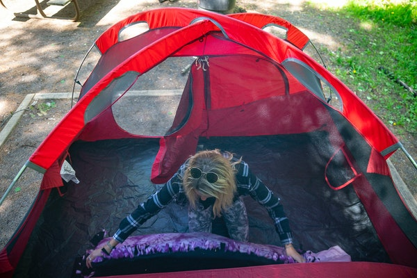 Meghan Wellner prepared her bedding at her campsite in Jay Cooke State Park in Carlton, Minn.