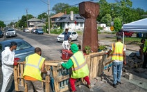 A crew from Agape arrived at George Floyd Square and attempted to remove shipping pallets placed on 38th Street to block traffic on June 8.