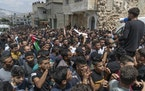 Palestinian mourners chant anti Israel slogans during the funeral of Ahmad Shamsa, 15, in the West Bank village of Beta, near Nablus, Thursday, June.