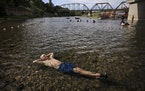 not used -- Gerry Huddleston of Santa Rosa, Calf. cools off in the very shallow water of the Russian River, Wednesday, June 16, 2021 at the Veterans M