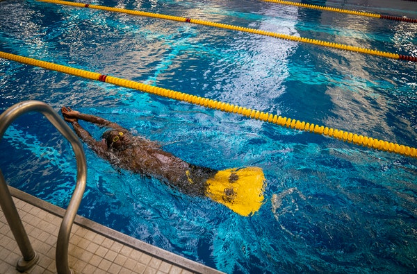 Swimmer Roderick Sewell warmed-up before the races began in the warm-up pool on the first day of preliminary races during the 2020 US Paralympic Team