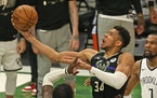 Milwaukee's Giannis Antetokounmpo shoots over the Nets' Jeff Green during Game 6 of the Eastern Conference Semifinals
