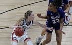 UConn guard Paige Bueckers (5) drives against High Point guard Chyna McMichel (22) during the first round of the NCAA women's basketball tournament.