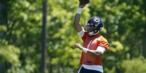 Chicago Bears quarterback Justin Fields works on the field during NFL football practice this week.