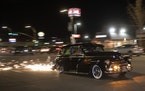 A metal plate attached to the bottom of the car sprayed sparks during cruise night on Van Nuys Boulevard.
