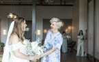 Gretchen Culver, right, the founder of Rocket Science Events and Minne Weddings, at the June 6 wedding of Catie Hawk, left, in Minneapolis. As nuptial