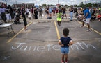 People tried out double Dutch at last year's Juneteenth celebration in the parking lot of the Target on E. Lake Street in Minneapolis.