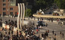 Police arrived on the I-35W bridge in Minneapolis on May 31, 2020, after a tanker truck was driven into a large group of demonstrators marching to pro