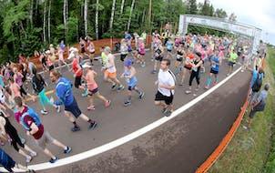 Runners took off along the start of the Gary Bjorklund Half Marathon on Saturday morning.