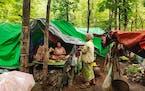 Internally displaced women talk at their makeshift tents at Pu Phar Village, Demawso Township, Kayah State on Thursday, June 17, 2021.