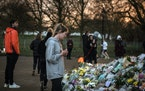 A makeshift memorial grew in London in March after a police officer was arrested in the killing and rape of Sarah Everard.