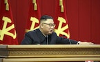 In this photo provided by the North Korean government, North Korean leader Kim Jong Un attends a Workers' Party meeting in Pyongyang, North Korea, F