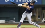 Max Kepler hits a single and drives in a run during the first inning of a game against the Texas Rangers in Arlington, Texas on Friday